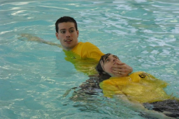 A young man simulates how to save someone from drowning...